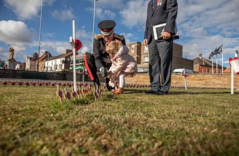 Northamptonshire Lord Lieutenant with child and poppy crosses